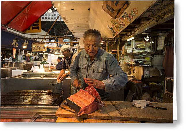 Fishmongers Greeting Cards - Fishmonger cutting a tuna in Tsukiji Fish Market Greeting Card by Ruben Vicente