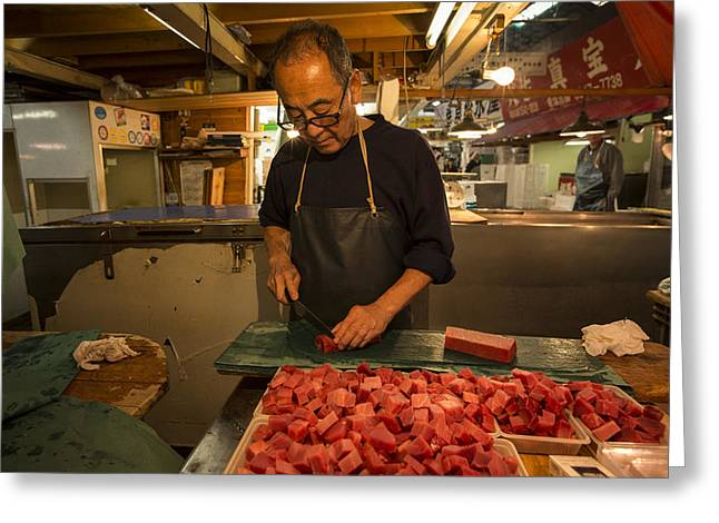 Fishmongers Greeting Cards - Fishmonger cutting tuna in Tsukiji Fish Market Greeting Card by Ruben Vicente
