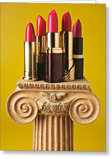 Appearances Greeting Cards - Five red lipstick tubes on pedestal Greeting Card by Garry Gay