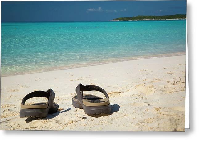 Flip Flops On A Sandy Beach Greeting Card by Brian Jannsen