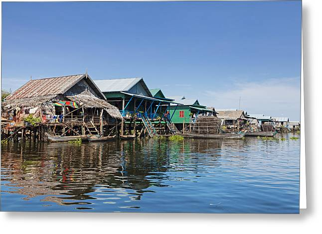 Floating House Greeting Cards - Floating fishing village Greeting Card by Alexey Stiop