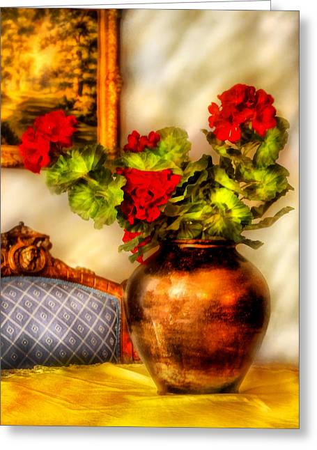Red Geraniums Photographs Greeting Cards - Flower - Geraniums on a table  Greeting Card by Mike Savad