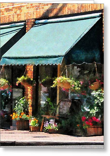 Flowerpots Greeting Cards - Flower Shop With Green Awnings Greeting Card by Susan Savad