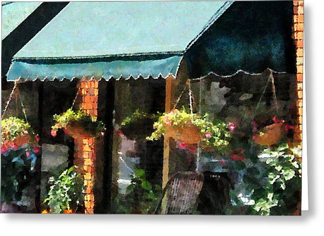 Flower Shop With Green Awnings Greeting Card by Susan Savad