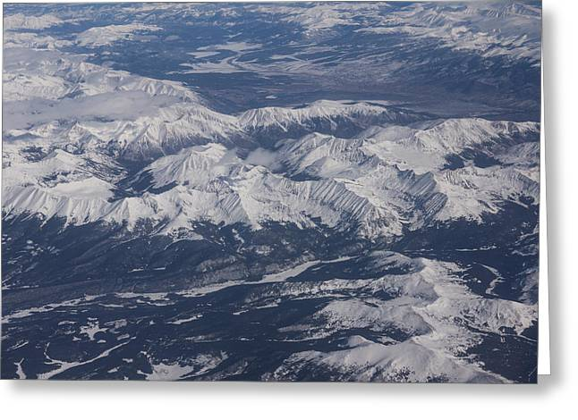 Snow-covered Landscape Greeting Cards - Flying Over the Snow Covered Rocky Mountains Greeting Card by Georgia Mizuleva