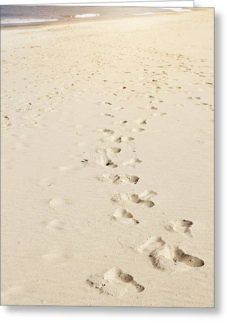 Sand Greeting Cards - Foot prints Greeting Card by Les Cunliffe