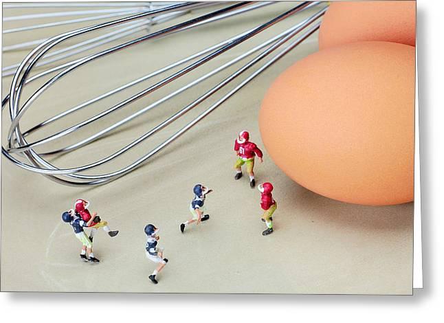 Footballs Closeup Greeting Cards - Football match among eggs miniature art Greeting Card by Paul Ge