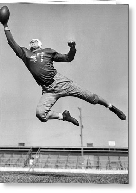 Football Player Catching Pass Greeting Card by Underwood Archives