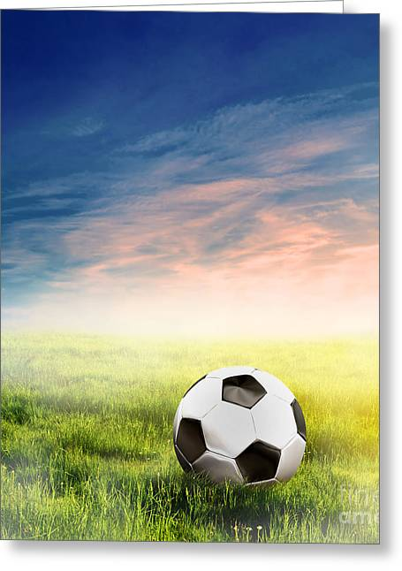 Sporting Equipment Greeting Cards - Football soccer ball on green grass Greeting Card by Michal Bednarek