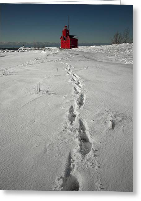 Randy Greeting Cards - Footprints leading from the Lighthouse Big Red during Winter Greeting Card by Randall Nyhof