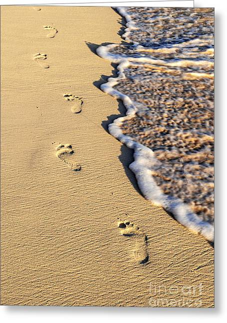 Beaches Greeting Cards - Footprints on beach Greeting Card by Elena Elisseeva