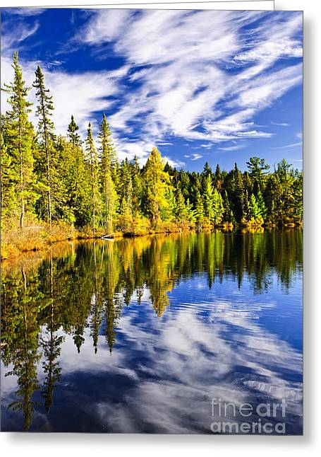 Yellow Reflections Greeting Cards - Forest and sky reflecting in lake Greeting Card by Elena Elisseeva