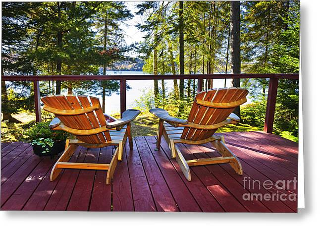 Wooded Park Greeting Cards - Forest cottage deck and chairs Greeting Card by Elena Elisseeva