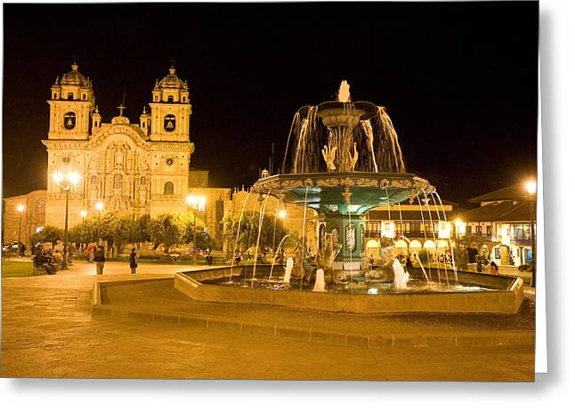 Town Square Greeting Cards - Fountain Lit Up At Night At A Town Greeting Card by Panoramic Images