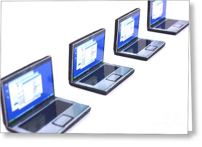 Manufacturing Greeting Cards - Four mini laptops in a perspective line Greeting Card by Simon Bratt Photography LRPS