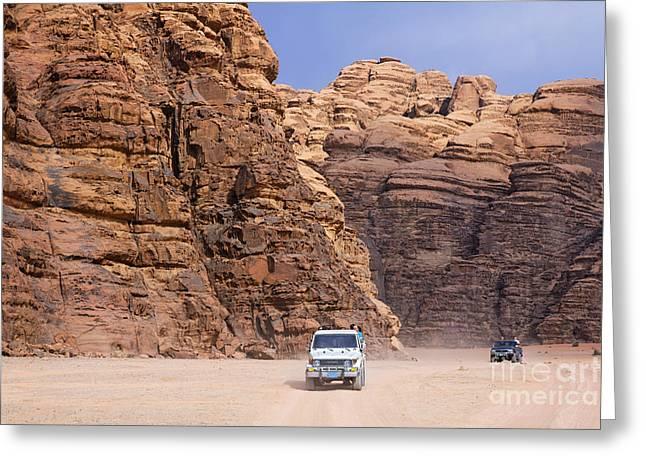 Jordan Photographs Greeting Cards - Four wheel drive vehicles at Wadi Rum Jordan Greeting Card by Robert Preston