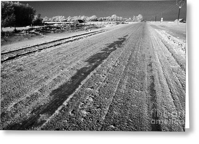 Harsh Conditions Greeting Cards - frozen salt and grit covered rural small road in Forget Saskatchewan Canada Greeting Card by Joe Fox