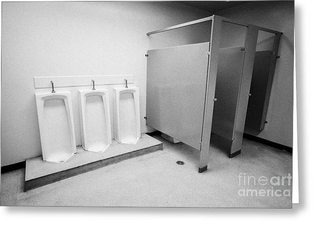 full length urinals and cubicles in mens toilet of High school canada north america Greeting Card by Joe Fox