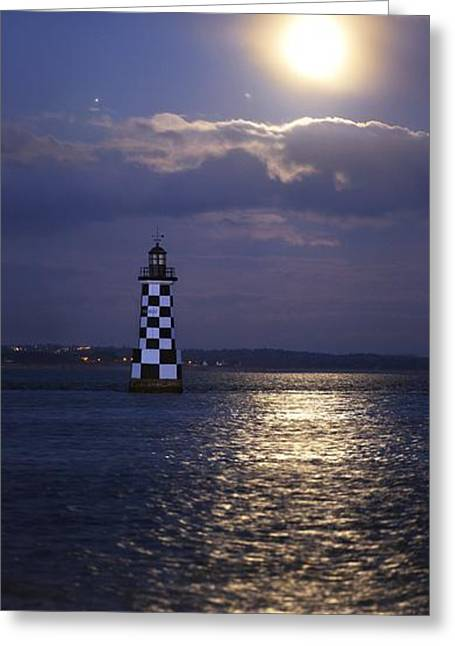 Sea Moon Full Moon Greeting Cards - Full moon and Jupiter over a lighthouse Greeting Card by Science Photo Library