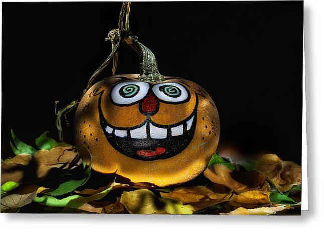 Trick-or-treaters Greeting Cards - Funny Whimsical Halloween Pumpkin in a Bed of Fall Leaves Greeting Card by Wendy Thompson