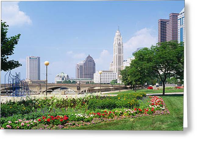 Garden Scene Photographs Greeting Cards - Garden In Front Of Skyscrapers Greeting Card by Panoramic Images