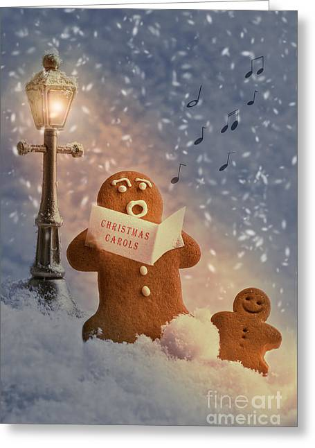 Snowy Night Greeting Cards - Gingerbread Carol Singers Greeting Card by Amanda And Christopher Elwell