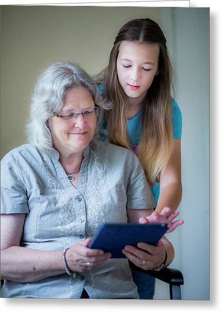Girl And Grandmother Using Tablet Greeting Card by Samuel Ashfield