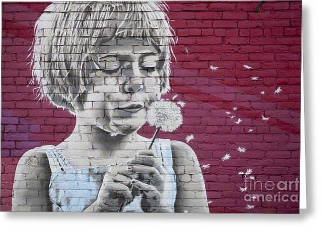 Girl Blowing A Dandelion Greeting Card by Chris Dutton
