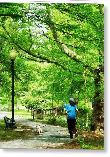Jogging Greeting Cards - Girl Jogging with Dog Greeting Card by Susan Savad
