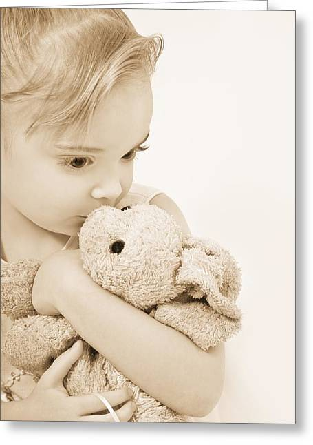 Considerate Greeting Cards - Girl Kissing Her Stuffed Animal Greeting Card by Chris and Kate Knorr