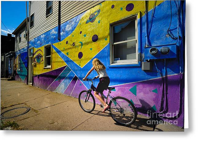 Biker Greeting Cards - Girl Rides Bicycle Past Mural on the South Side of Pittsburgh Greeting Card by Amy Cicconi