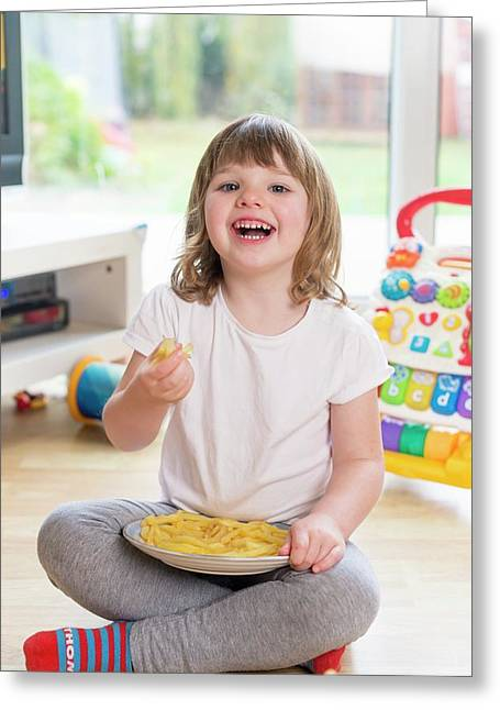 Girl Sitting On Floor Eating French Fries Greeting Card by Aberration Films Ltd