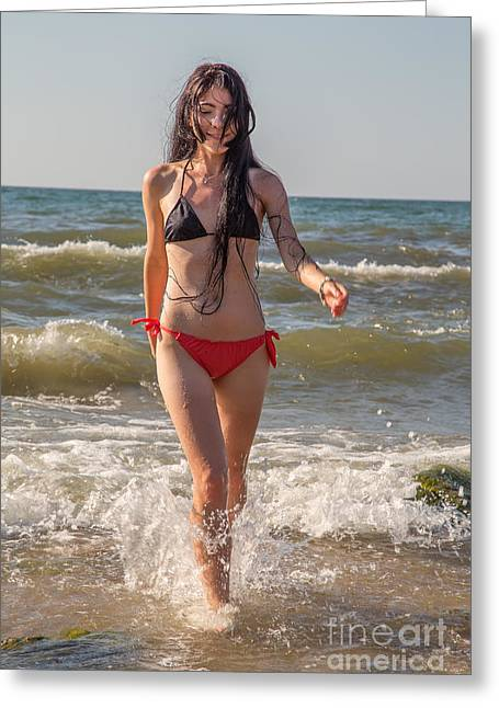 Surf Lifestyle Photographs Greeting Cards - Girl Walking In Sea Surf Greeting Card by Aleksey Tugolukov