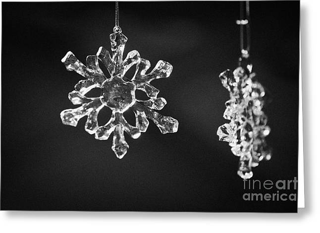 Berlin Germany Greeting Cards - glass crystal snowflake pendants hanging on a christmas stall in Berlin Germany Greeting Card by Joe Fox