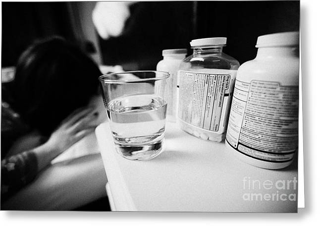 Pill Bottle Greeting Cards - Glass Of Water And Bottles Of Pills On Bedside Table Of Early Twenties Woman Waking In Bed In A Bedr Greeting Card by Joe Fox