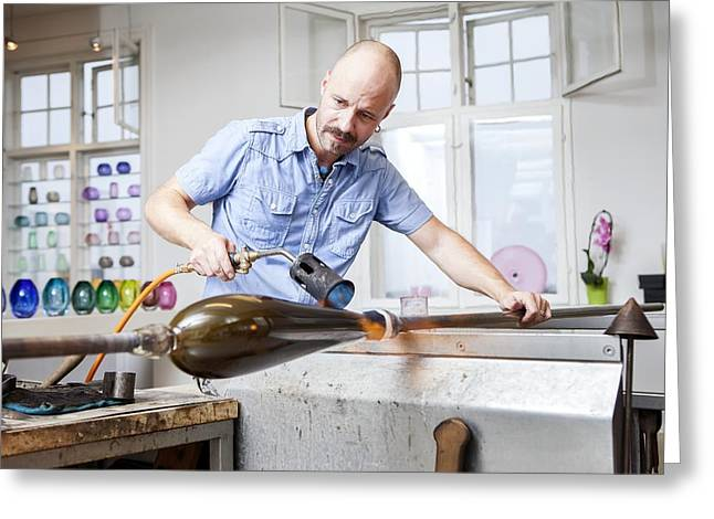 Glassblower At Work Greeting Card by Thomas Fredberg