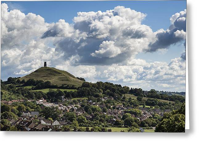 Tor Greeting Cards - Gloastonbury Tor and village on beautiful blue sky Summer day Greeting Card by Matthew Gibson