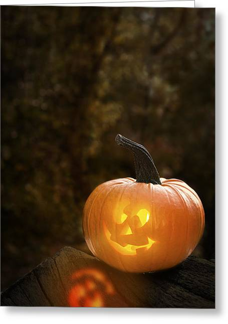 Tricks Greeting Cards - Glowing Pumpkin Greeting Card by Amanda And Christopher Elwell