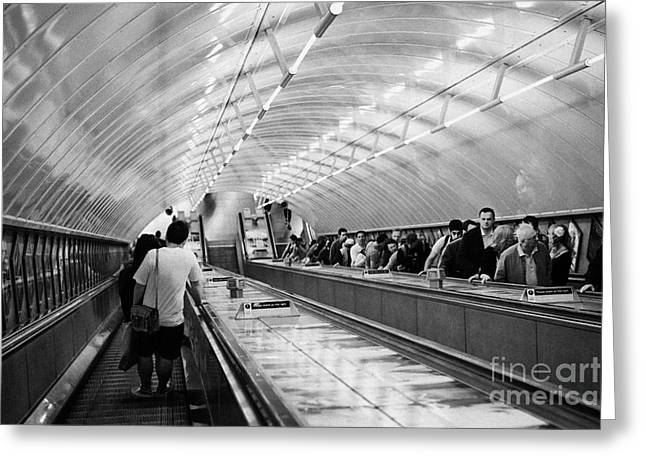 Going Down Greeting Cards - going down steep down escalator in tube station London England UK Greeting Card by Joe Fox