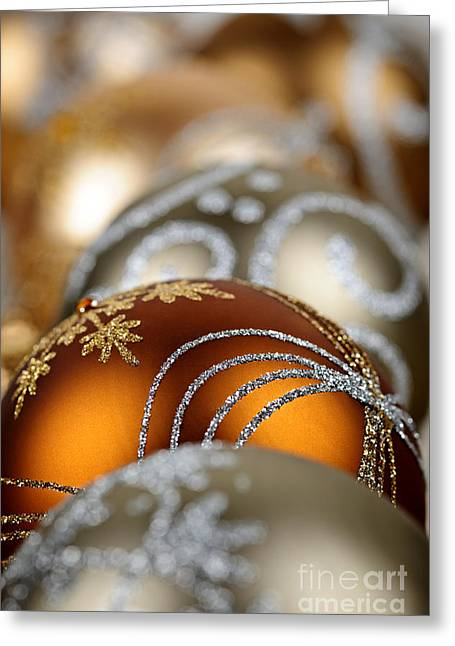 Baubles Greeting Cards - Gold Christmas ornaments Greeting Card by Elena Elisseeva