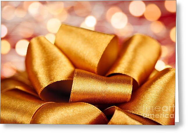Surprise Greeting Cards - Gold gift bow with festive lights Greeting Card by Elena Elisseeva