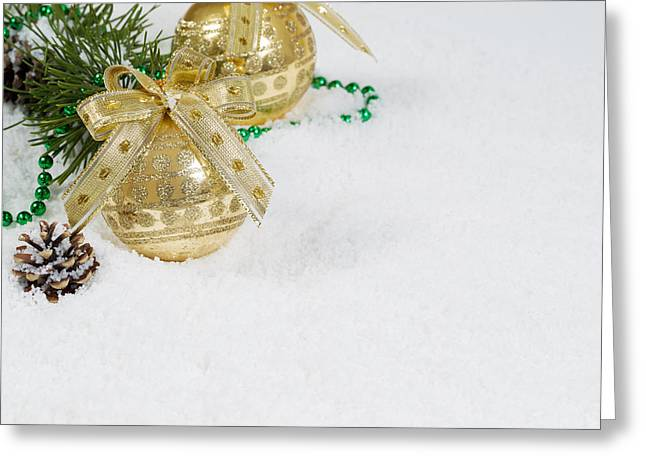 Christmas Eve Greeting Cards - Golden Christmas Ornament on Snow  Greeting Card by Tom  Baker