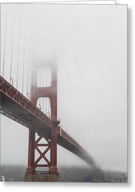 Golden Gate Bridge Shrouded In Fog Greeting Card by Adam Romanowicz