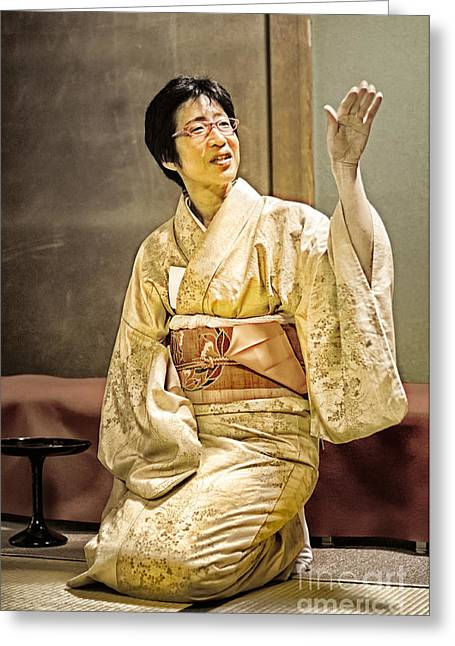 Tatami Greeting Cards - Golden Glow - Japanese lady in traditional kimono explains the tea ceremony Greeting Card by David Hill