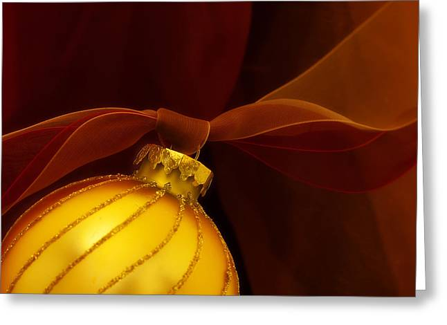 Golden Ornament With Red Ribbons Greeting Card by Carol Leigh