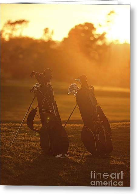 Golf Photographs Greeting Cards - Golf bags at sunset Greeting Card by Diane Diederich