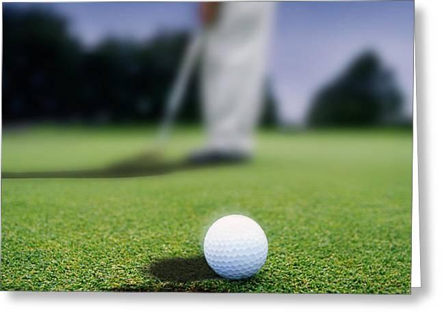 Golf Ball Near Cup Greeting Card by Darren Greenwood