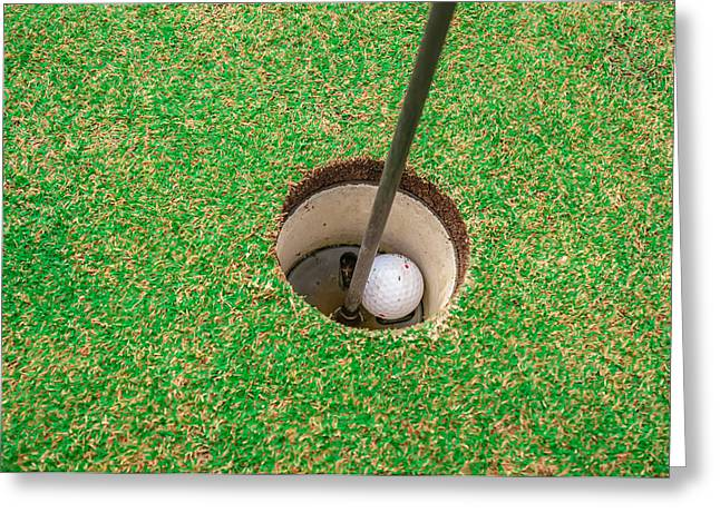 Golfcourse Greeting Cards - Golf ball on a green in front of the hole Greeting Card by Alexandr Grichenko