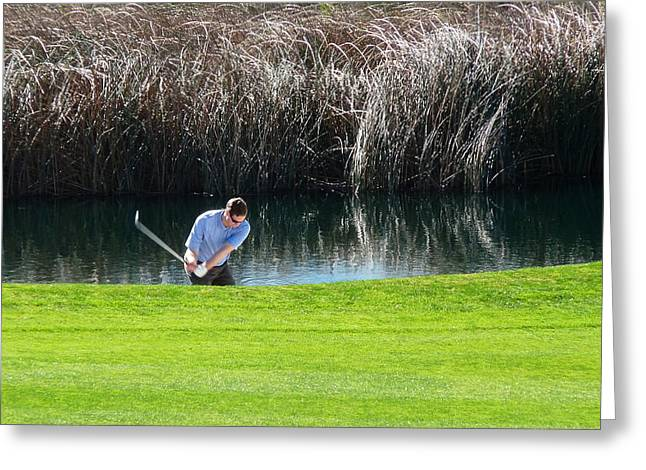 Trump Golf Course Greeting Cards - Golfer Swing Water Hazard Greeting Card by Jeff Lowe