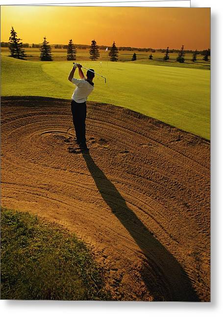 Golf Hole Greeting Cards - Golfer Taking A Swing From A Golf Bunker Greeting Card by Darren Greenwood